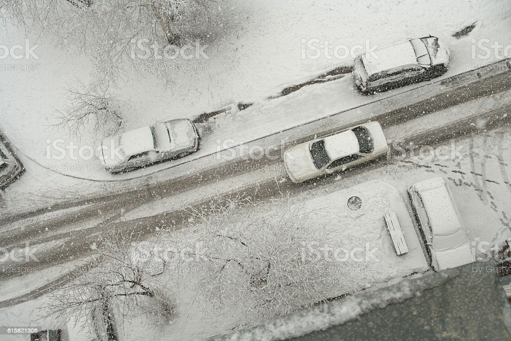 blizzard on a city street. stock photo
