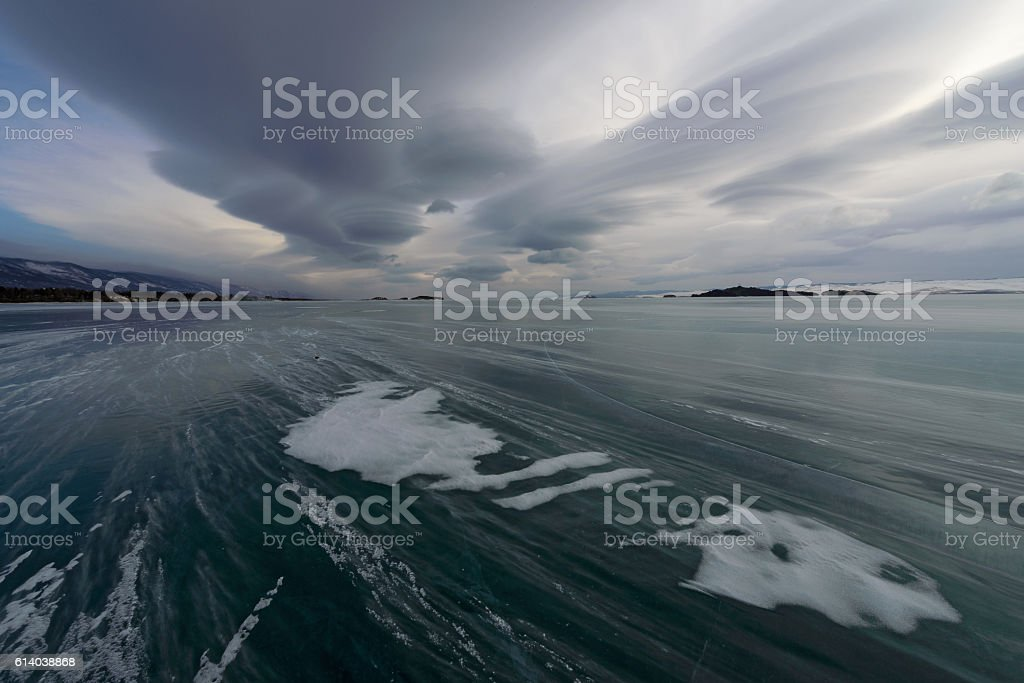 Blizzard, snow flying across the ice, the sky, lenticular clouds stock photo