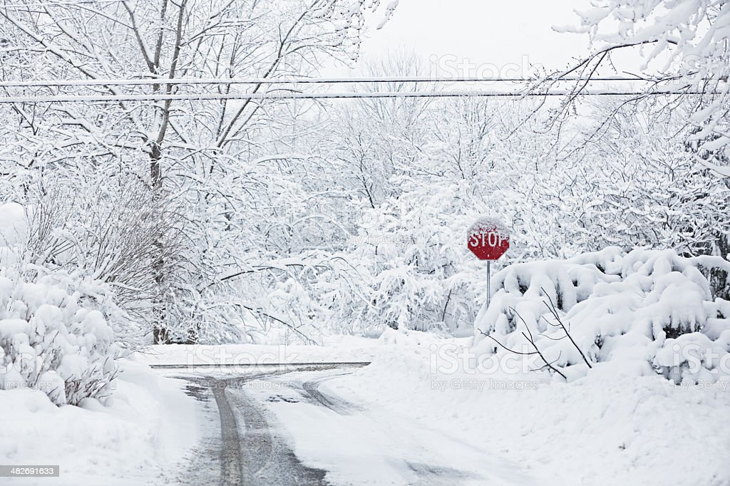 Blizzard Snow Road Intersection Stop Sign stock photo