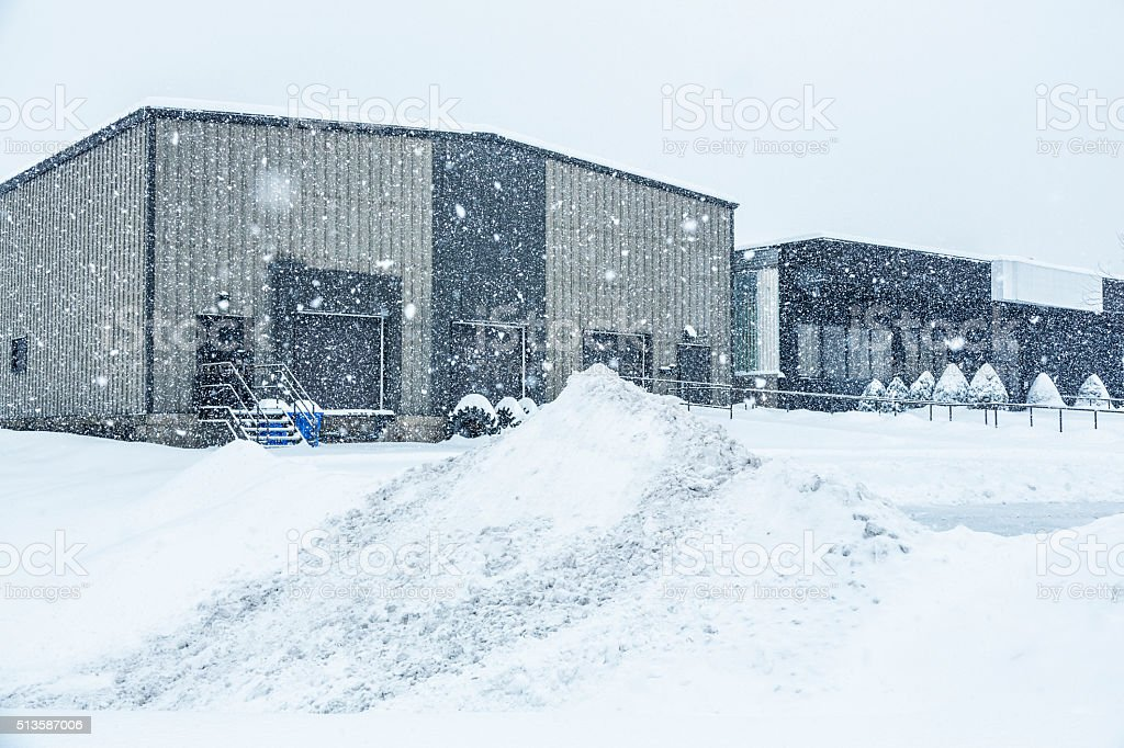 Blizzard Snow Storm Industrial Warehouse Office Building stock photo