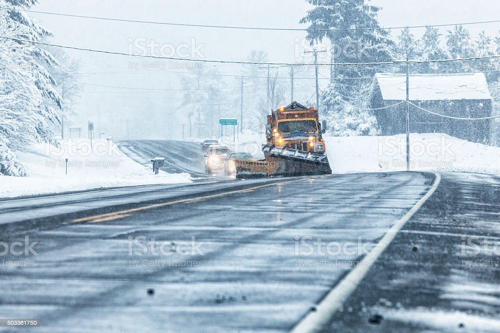 Blizzard Snow Storm Rural Highway Snow Plow Dump Truck stock photo