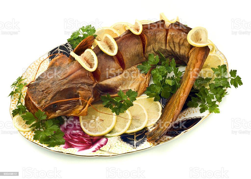 Bloated sheatfish with lemon and parsley royalty-free stock photo