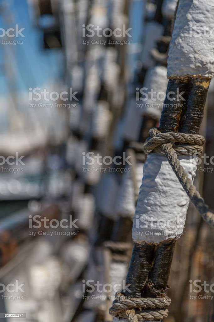 Block and tackle with ropes and railings - vintage ship rigging. stock photo