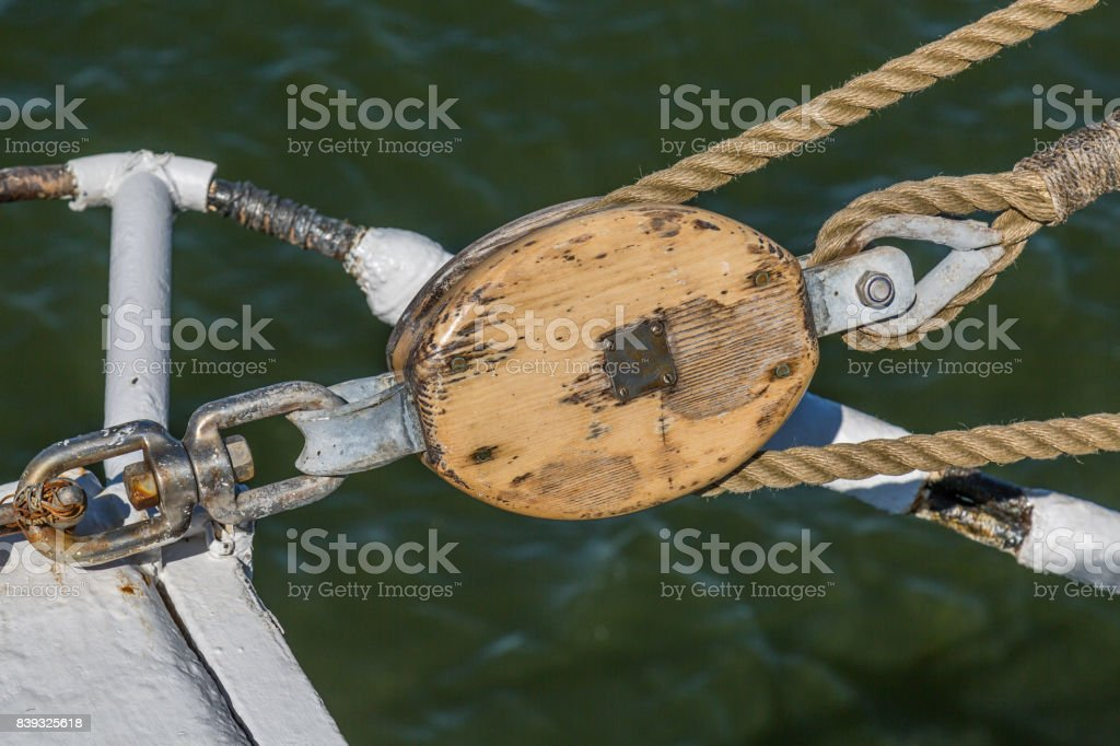 Block and tackle with ropes and railings - vintage ship rigging stock photo