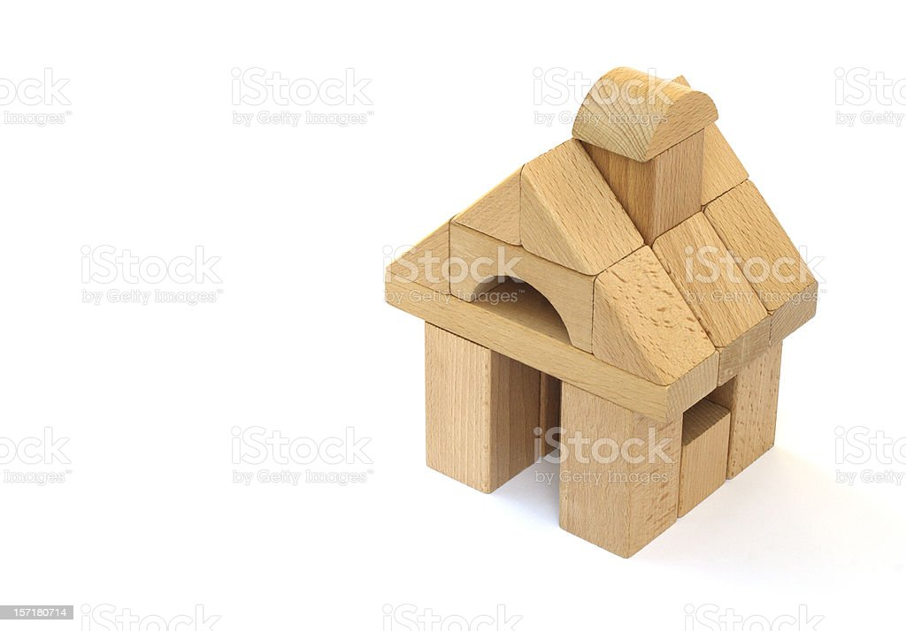 Block house made of childrens' building blocks, isolated on white royalty-free stock photo