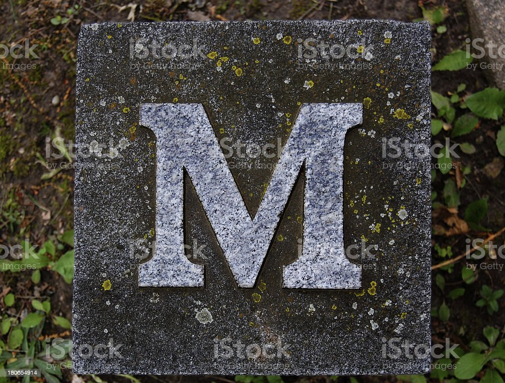 Block letter M in ground royalty-free stock photo