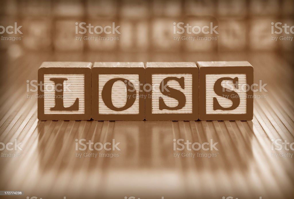 Block letters spelling out the word loss stock photo