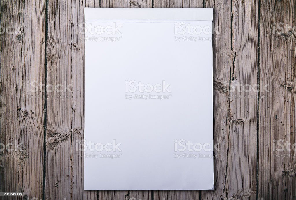 Block notes on old wooden board stock photo
