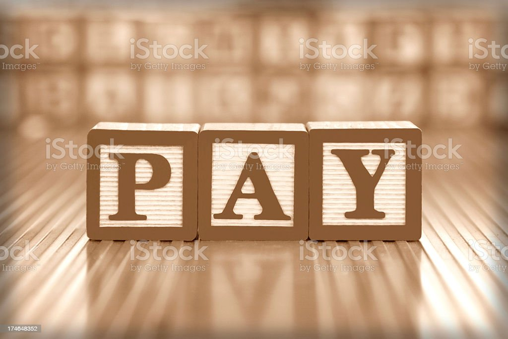 Block of cubes spelling out PAY stock photo