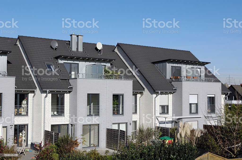 A block of modern attached houses with terrace and backyard royalty-free stock photo