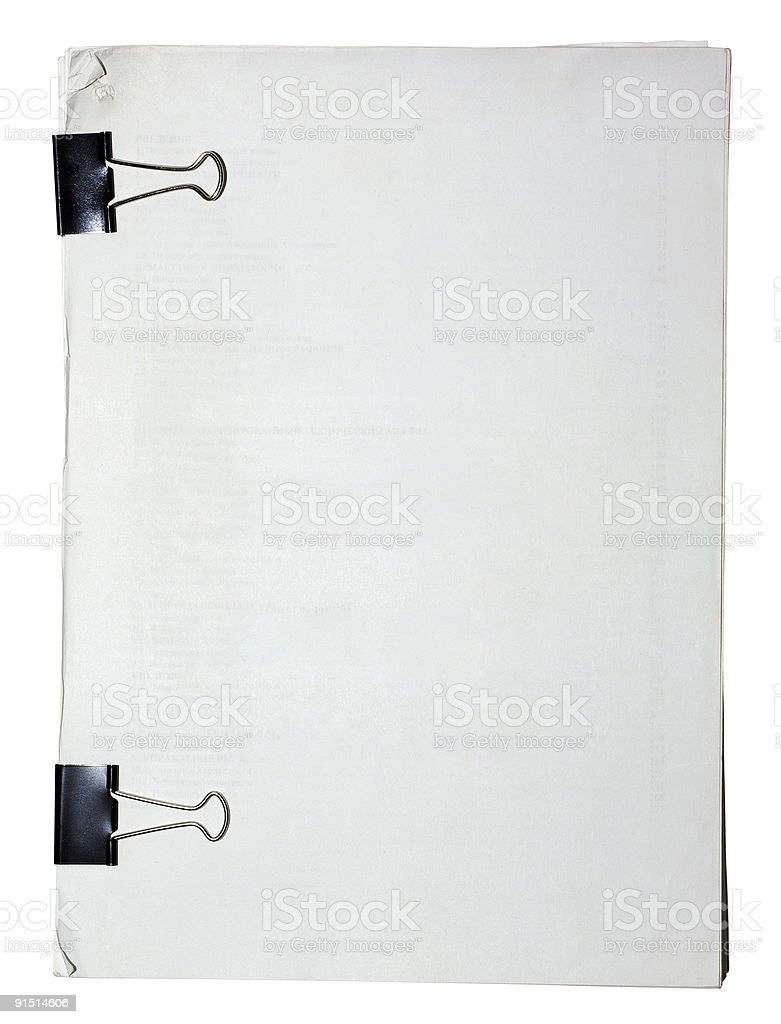 Block of paper attached with black clips. stock photo