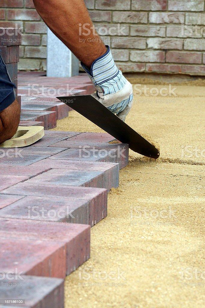 Block paving being layed royalty-free stock photo