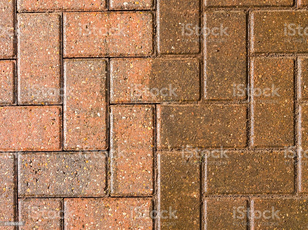 Block paving half jet washed and half still dirty stock photo