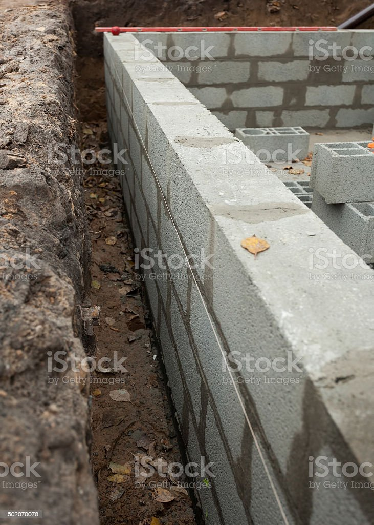 Block wall foundation for new house stock photo