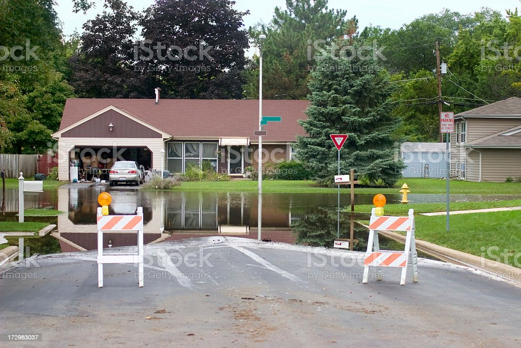 blocked flooded intersection stock photo