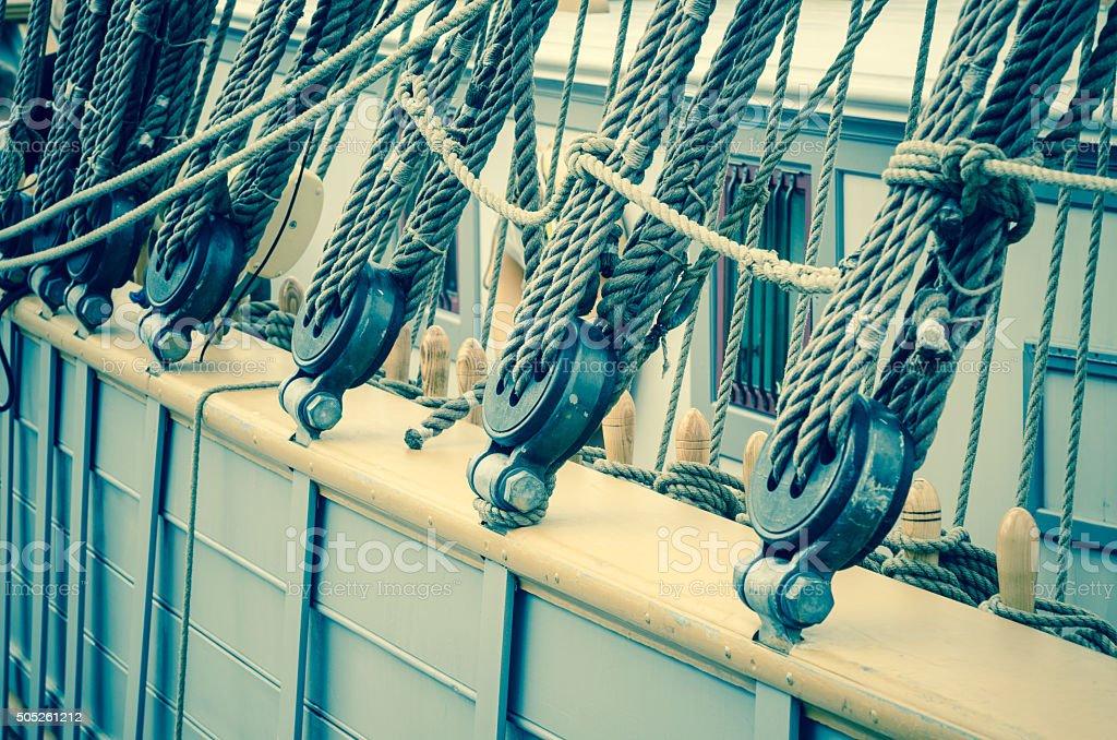 Blocks and rigging of an old sailboat, close-up, toning stock photo