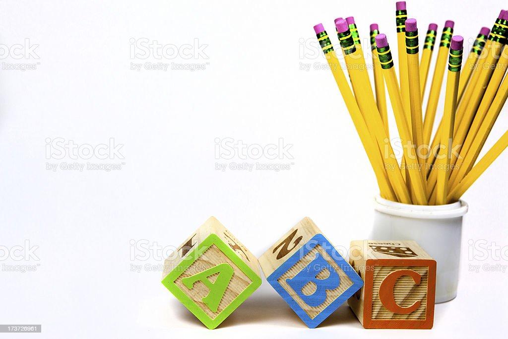 ABC blocks and yellow pencils stock photo