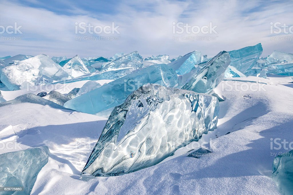 Blocks of blue natural ice on sky background stock photo