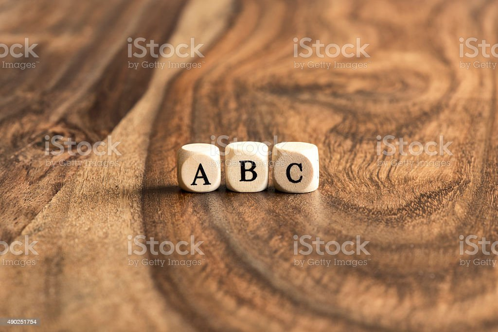 ABC blocks on wooden background stock photo