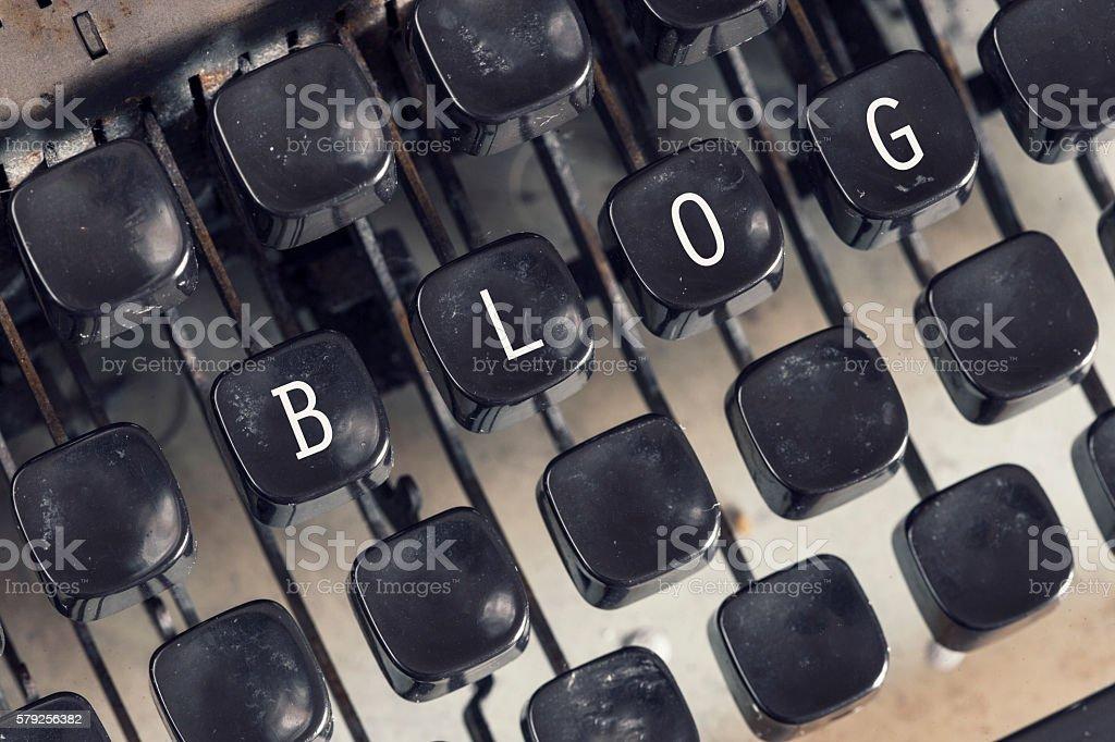 Blog message written on vintage typewriter keys stock photo