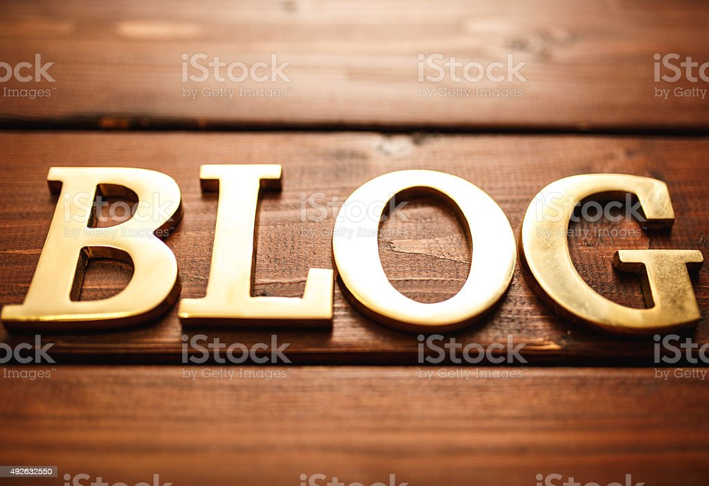 Blog - Metal gold text on wood stock photo