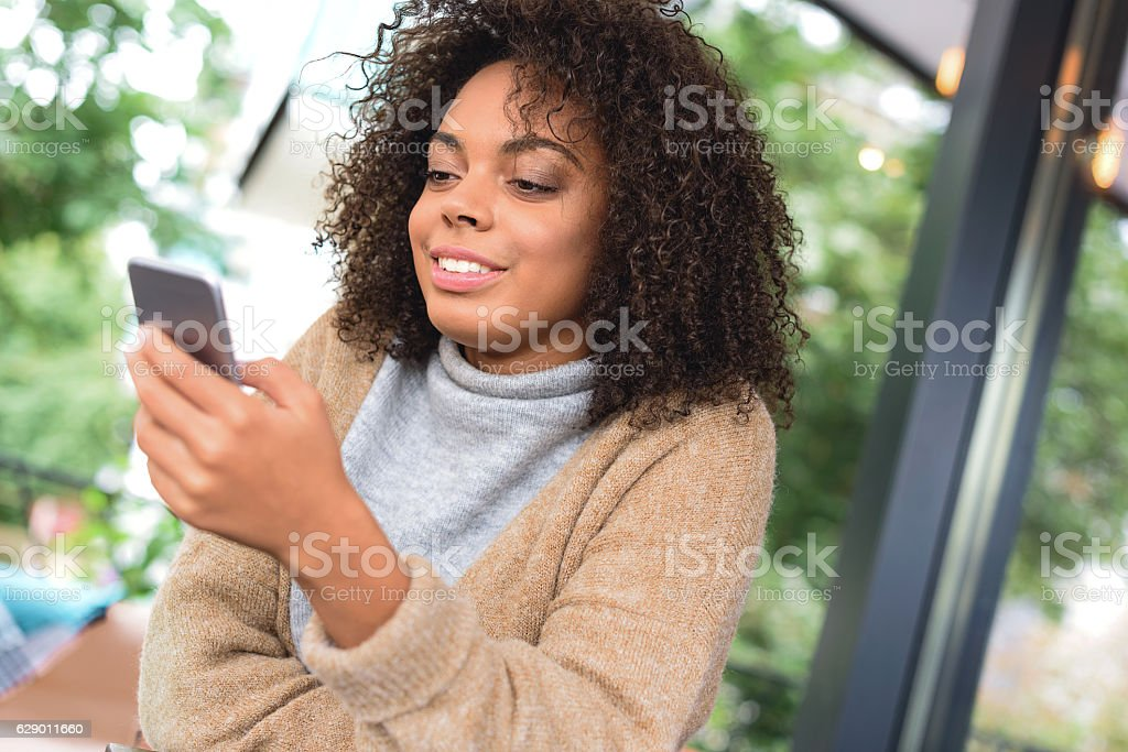 blogger checking her smartphone for news stock photo