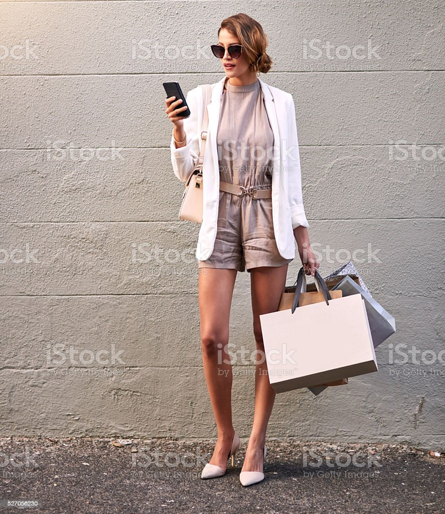 Blogging about the nice boutique she just found stock photo