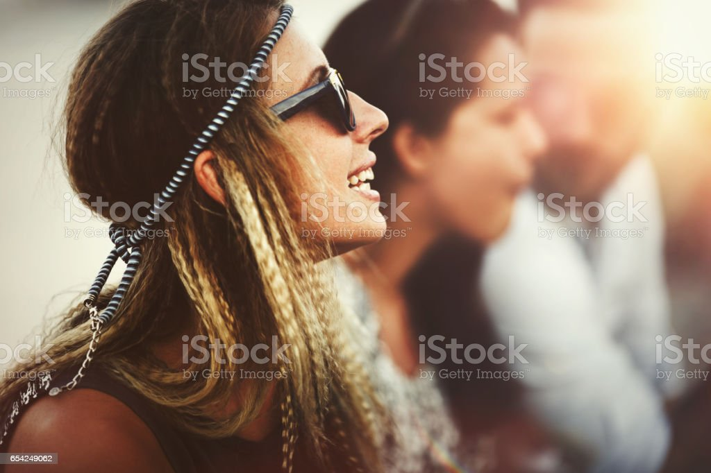 Blond afro woman enjoying summer festival and having fun stock photo