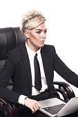 Blond beautiful business lady in black suit