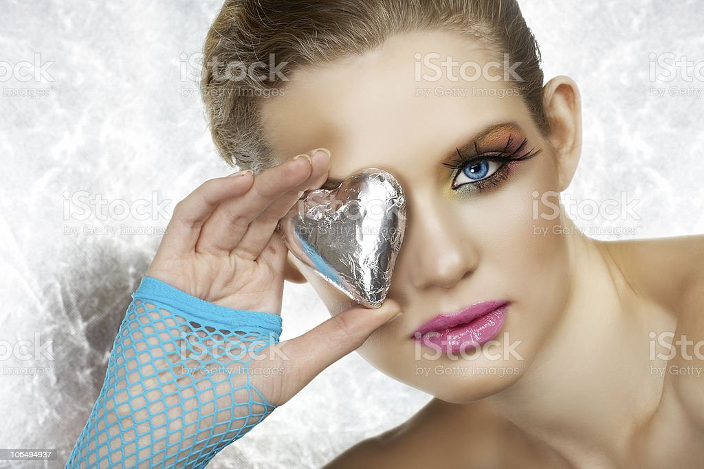 Blond beautiful woman with heart royalty-free stock photo