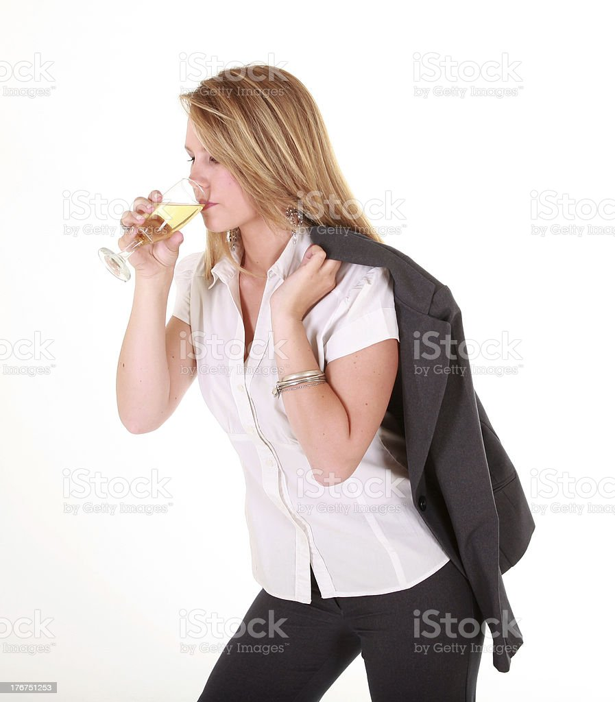 Blond business lady drinking champagne royalty-free stock photo