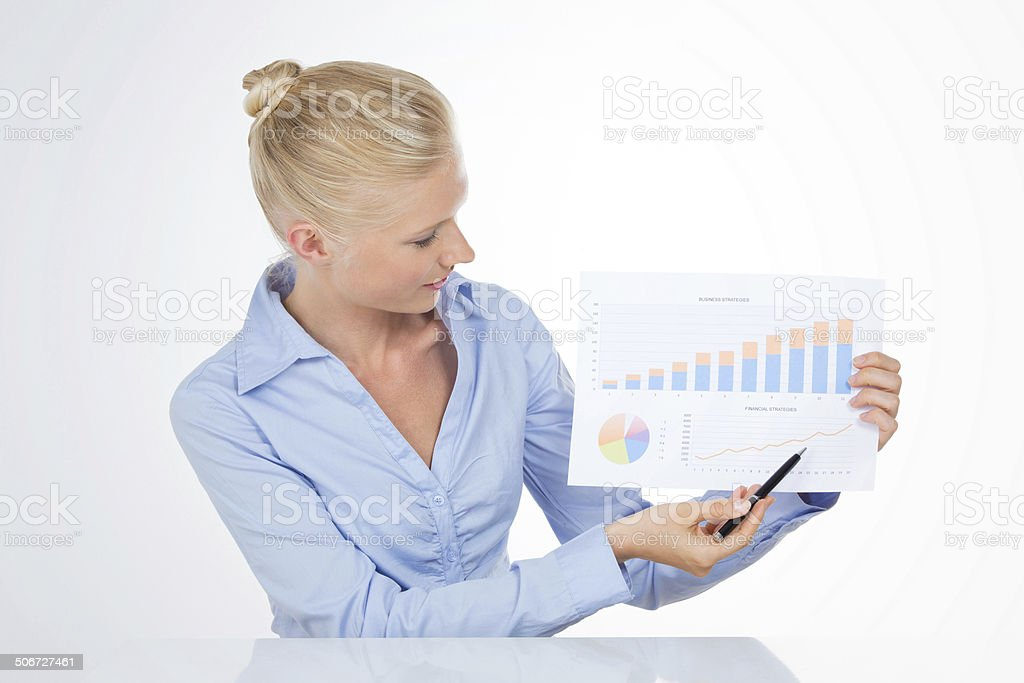 blond business woman pointing a chart with pen royalty-free stock photo