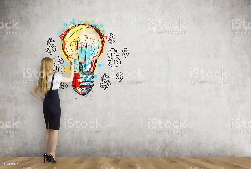 Blond businesswoman and light bulb with dollars stock photo