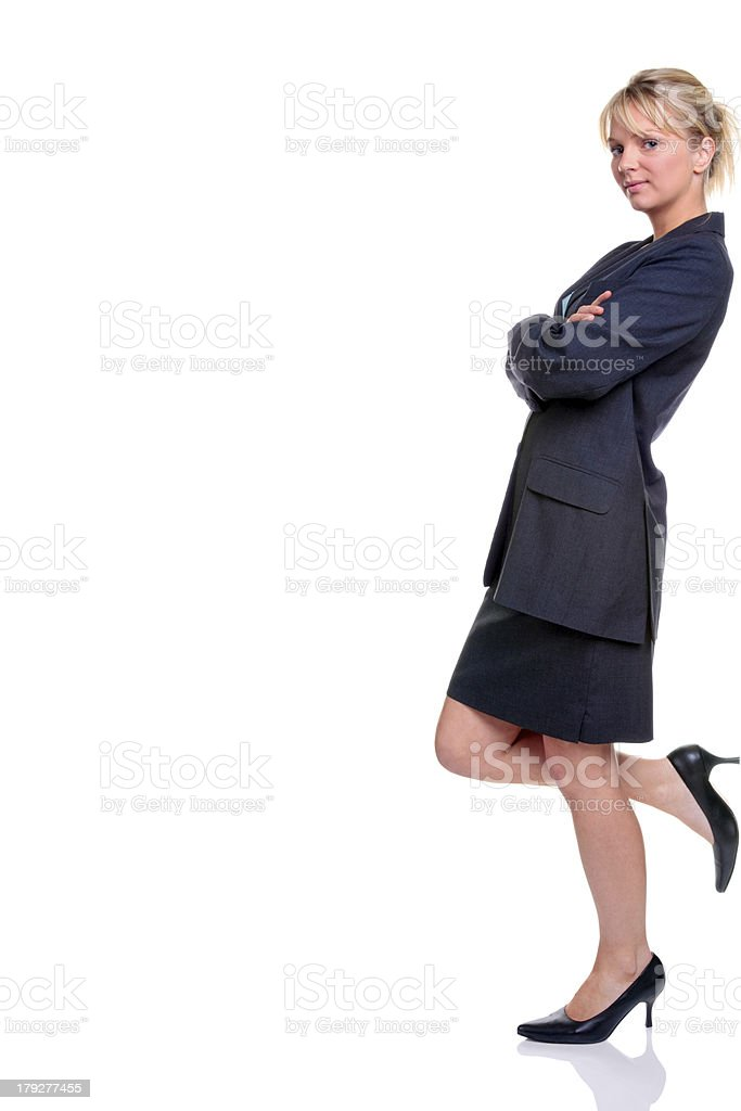 Blond businesswoman in suit leaning royalty-free stock photo