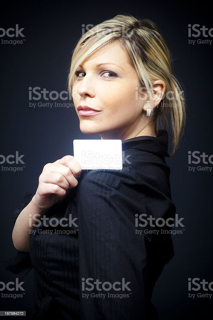Blond businesswoman with empty business card stock photo