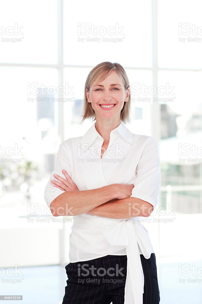 Blond businesswoman with folded arms royalty-free stock photo