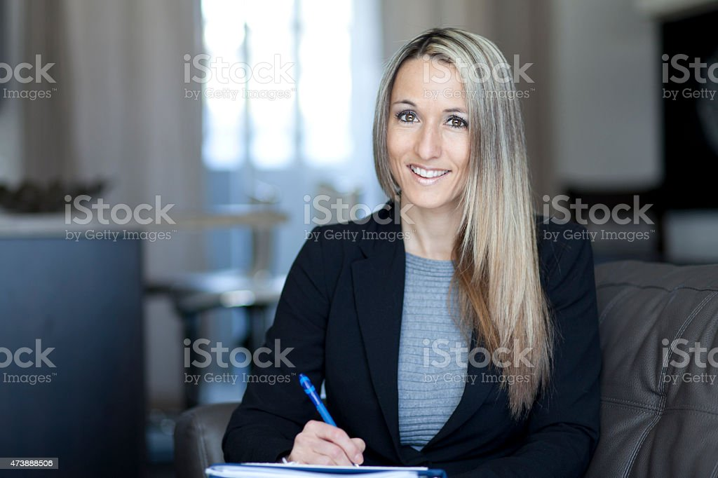 Blond Confident Businesswoman Working At Home stock photo