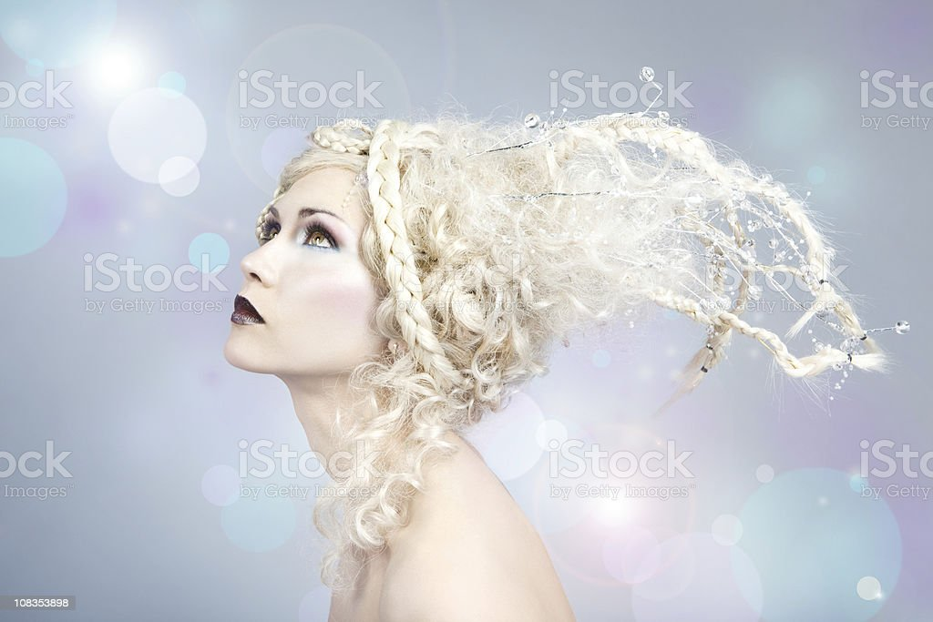 blond fairy looking at flying  lights stock photo