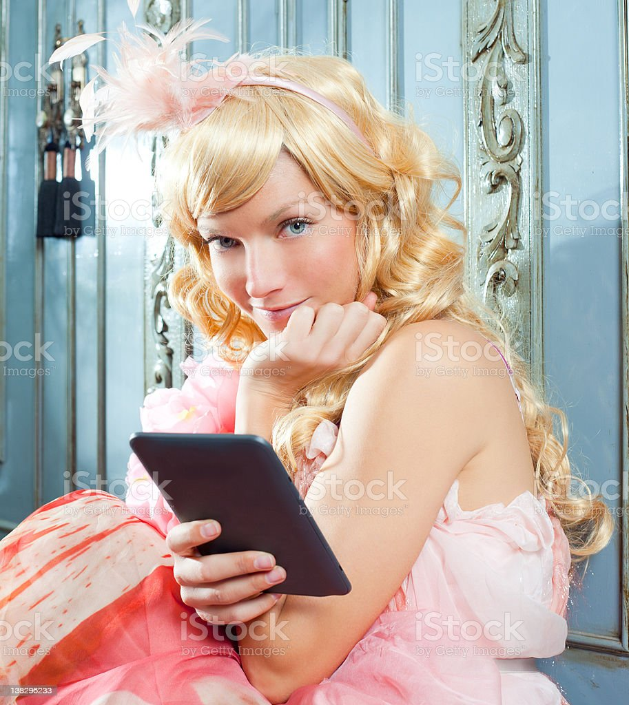 blond fashion princess woman reading ebook tablet royalty-free stock photo
