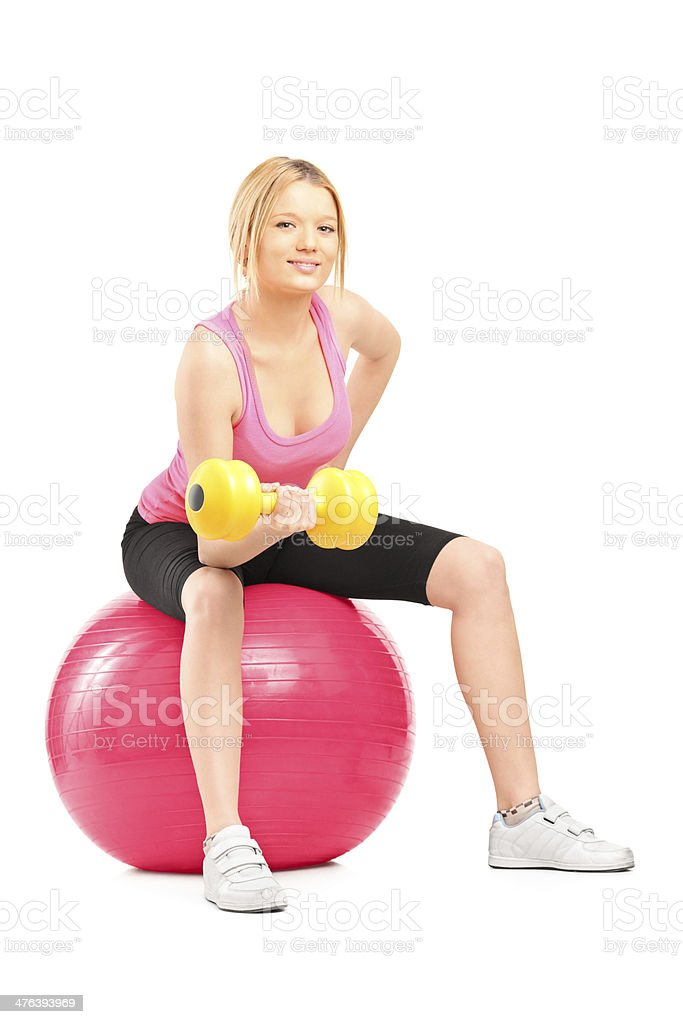 Blond female bodybuilder lifting up a dumbbell royalty-free stock photo