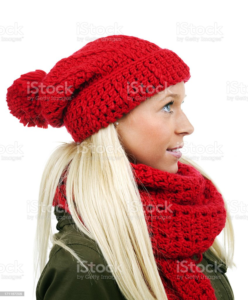 blond female with red poodle hat and scarf on white royalty-free stock photo