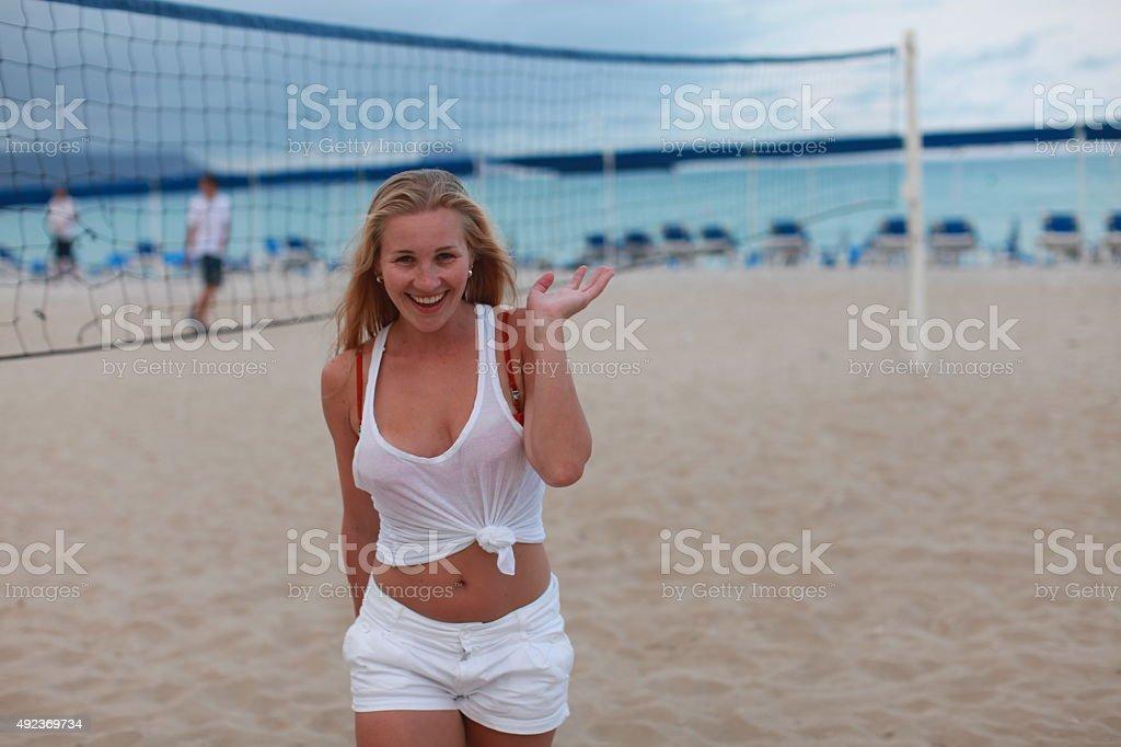 Blond girl has fun on the beach stock photo