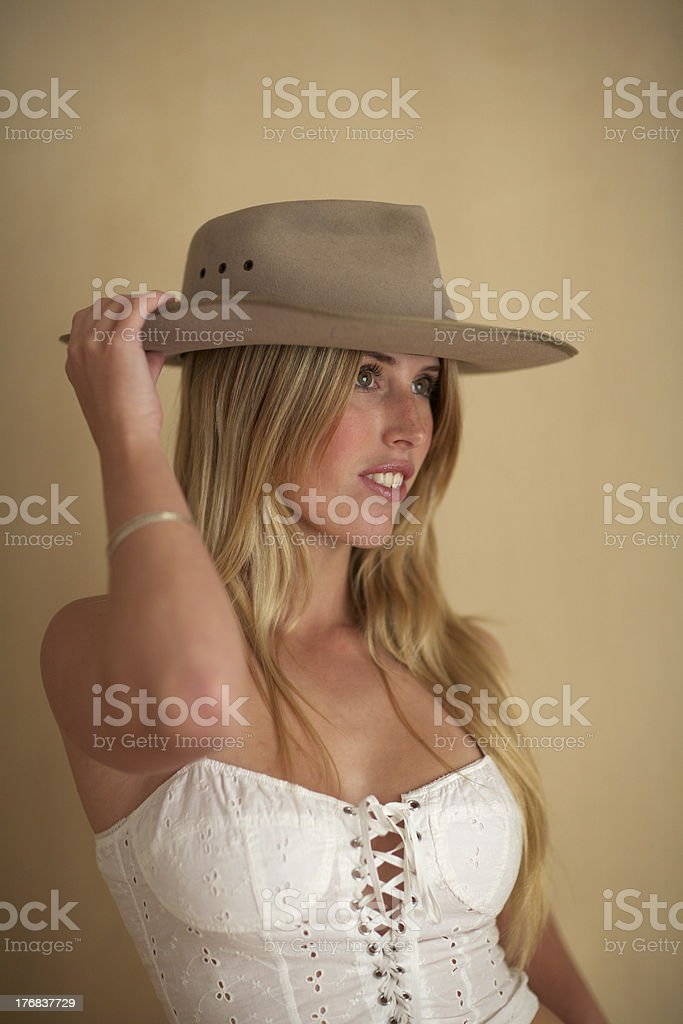 Blond Girl in Australian Hat and White Bodice stock photo