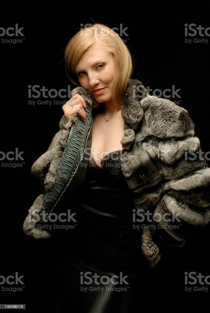 Blond girl in fur coat hand to her chick royalty-free stock photo
