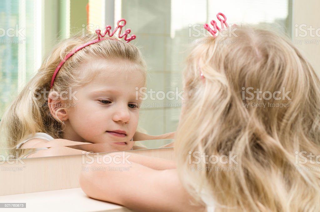 blond girl in mirror stock photo