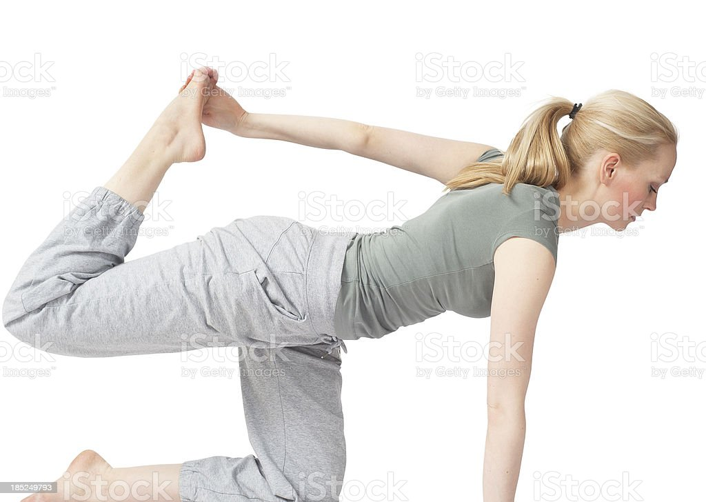 blond girl is exercising yoga training stock photo