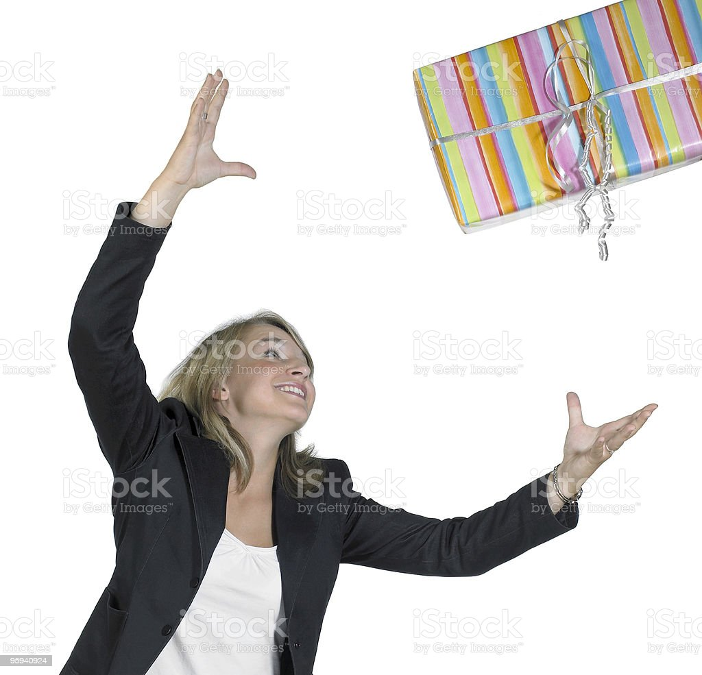 blond girl is throwing a present royalty-free stock photo