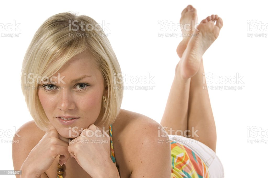 Blond girl laying down in summer dress royalty-free stock photo