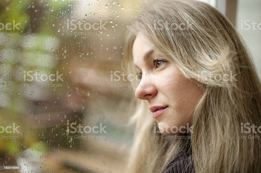 Blond girl looking far away royalty-free stock photo