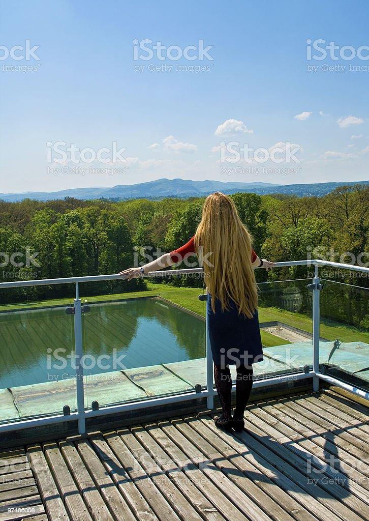 Blond girl looking into horizon stock photo